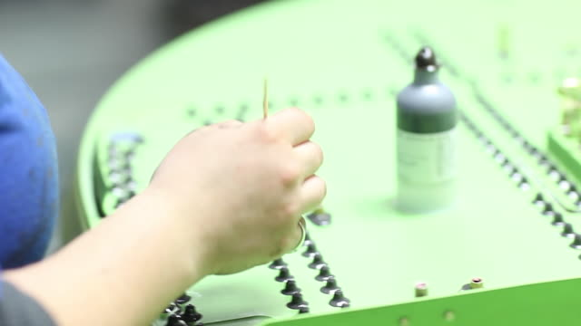 working with rivets in a manufacturing plant - repetition stock videos & royalty-free footage