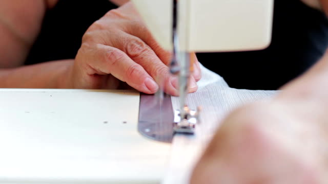 working with sewing machine - fashion designer stock videos and b-roll footage
