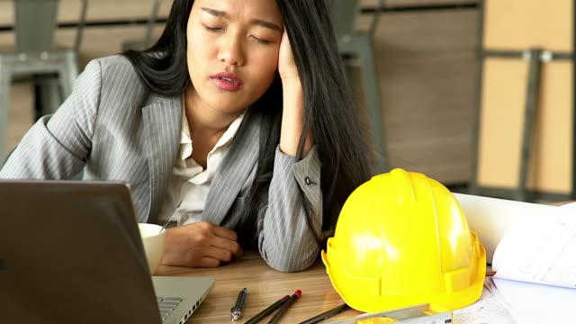 Working women engineers are sleepy because of hard work.