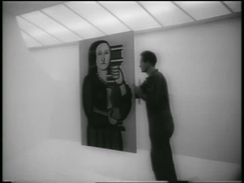 B/W 1959 workman adjusting painting in Guggenheim Museum / NYC / newsreel