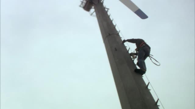 MS TU Workman climbing wind turbine/ Buffalo Ridge, Minnesota