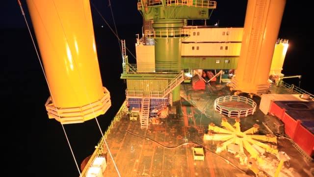 workman off the jack up barge krakken constructing the walney offshore windfarm off cumbria uk - health and safety stock videos & royalty-free footage