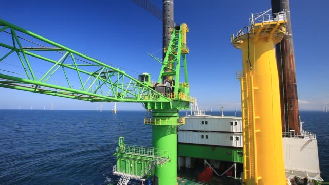 workman off the jack up barge, krakken constructing the walney offshore windfarm off cumbria, uk. - barge stock videos & royalty-free footage