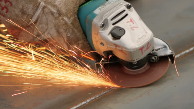 Workman with Grinding Machine