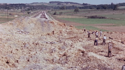 vidéos et rushes de workmen beginning repairs on bombed out section of railroad and roadway / france - reconstruction