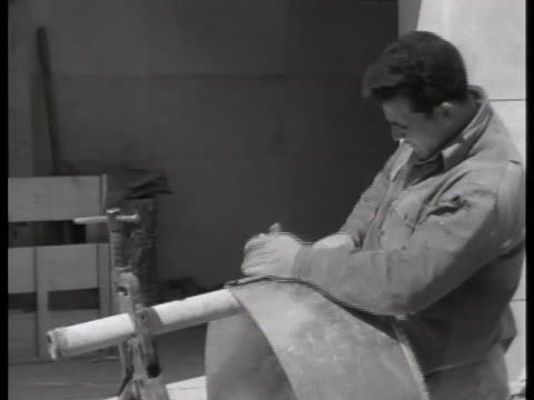 workmen build a bullet-proof witness booth for convicted war criminal adolf eichmann. - ゲシュタポ点の映像素材/bロール