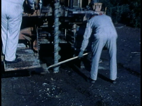 1978 zi workmen drilling with auger / united states - 1978 stock videos & royalty-free footage