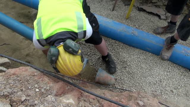 MS Workmen fitting water pipes in street / Konz, Rhineland-Palatinate, Germany