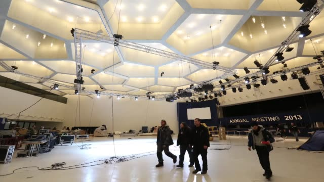 vídeos de stock, filmes e b-roll de workmen in main hall of the congress centre being set up in readiness for wef 2013 timelapse preparations for the 43rd world economic forum davos... - 2013