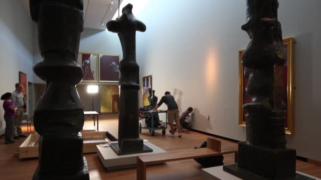 workmen install a sculpture by henry moore entitled 'king and queen' from 1952-53 in the ashmolean museum ahead of a major exhibition of works by... - henry moore stock videos & royalty-free footage