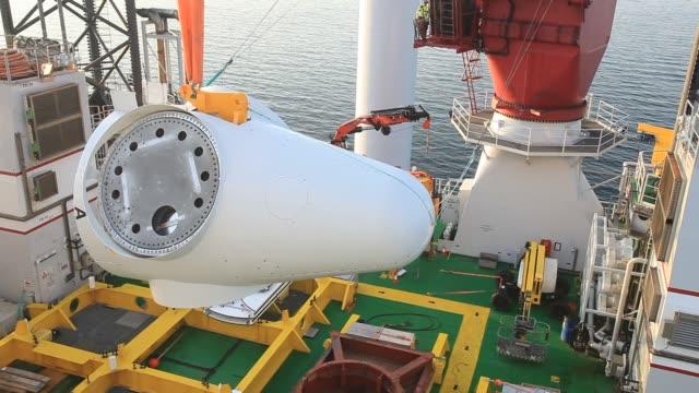 workmen off the jack up barge, krakken constructing the walney offshore windfarm off cumbria, uk. - building activity stock videos & royalty-free footage