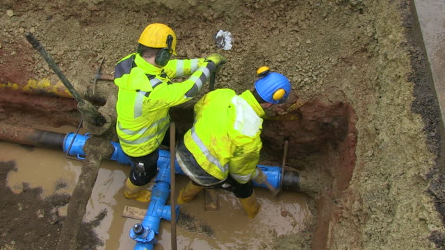 ms workmen repairing water pipes in street / konz, rhineland-palatinate, germany - water pipe stock videos & royalty-free footage