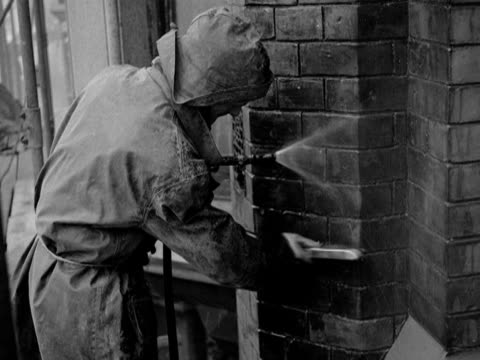 workmen scrub off the dirt and soot from a manchester building. 1953. - soot stock videos & royalty-free footage