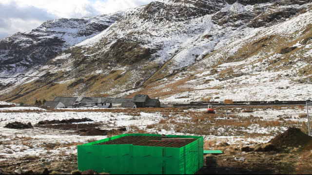 workmen start the initial groundworks for 3 wind turbines to be constructed behind the kirkstone pass inn on kirkstone pass in the lake district, uk. - permission concept stock videos & royalty-free footage