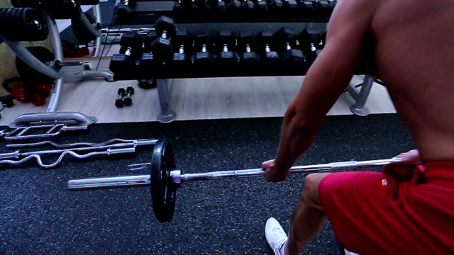 workout at the gym - arm curl stock videos & royalty-free footage