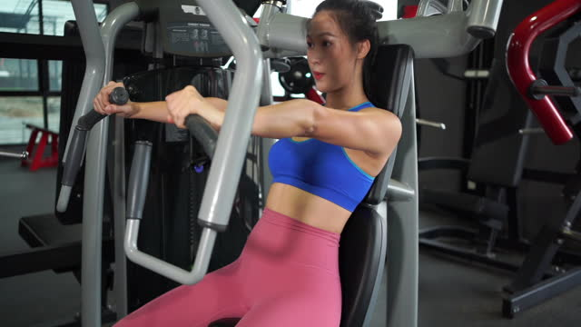 workout on butterfly exercise machine - chest torso stock videos & royalty-free footage