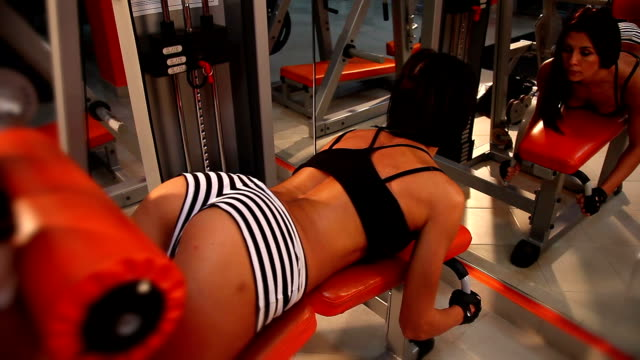 workout on exercise machine - prone leg curl - weight training stock videos and b-roll footage