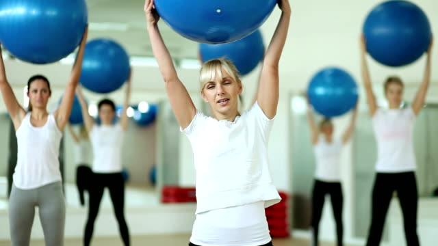 workout with gymnastic ball - fitness ball stock videos & royalty-free footage