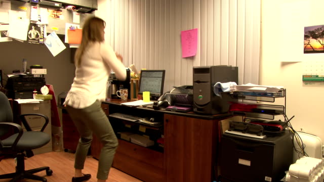 Workplace Exercise - Woman Working Out In Her Office