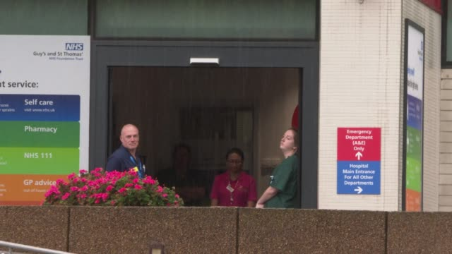 works stand in a doorway to observe a minute silence held on international workers memorial day to remember coronavirus victims who lost their lives... - doorway stock videos & royalty-free footage