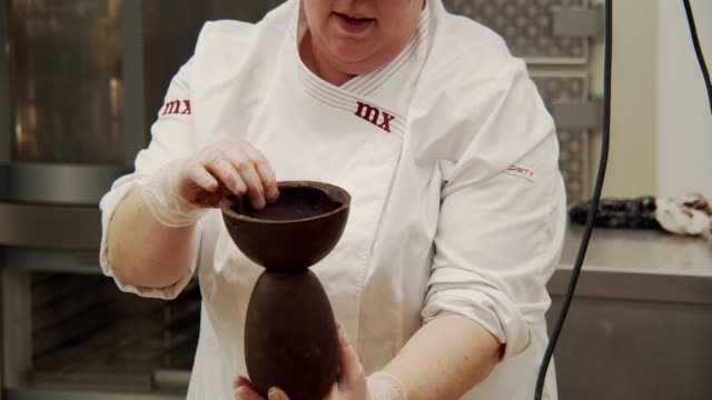 A workshop of 'Monas de Pascua' at Museu de la Xocolata in Barcelona Spain on April 20 2019 La Mona de Pascua is a Easter cake typical of Catalonia