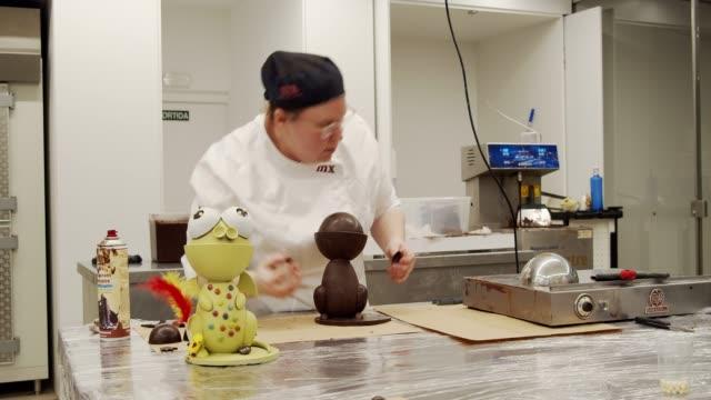 A workshop of 'Monas de Pascua' at Museu de la Xocolata in Barcelona Spain on April 20 2019 La Mona de Pascua is a Easter cake typical of Catalonia