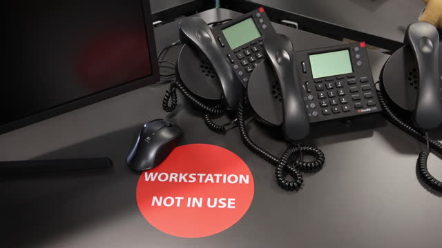 workstation not in use sticker on a desk in the offices of n+1 singer ltd., during a tour showcasing coronavirus safety measures, in the city of... - western script stock videos & royalty-free footage