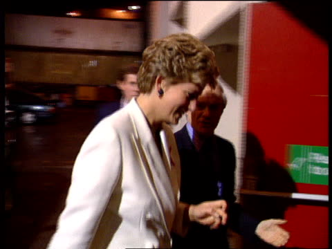 world aids day; england london cms princess of wales l-r cms princess shaking hands with george michael after charity concert - aids awareness ribbon stock videos & royalty-free footage