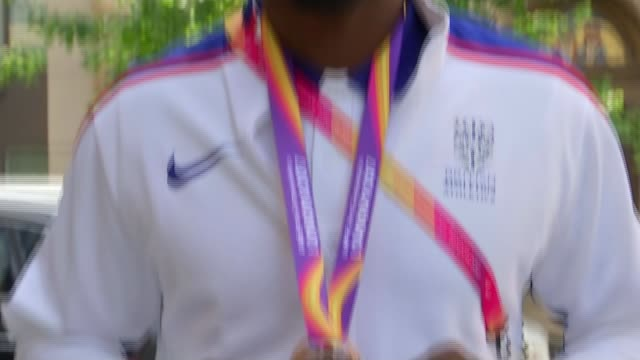 Great Britain win two more relay medals Dwayne Cowan posing with bronze medal Close shot of bronze medal Dwayne Cowan interview SOT