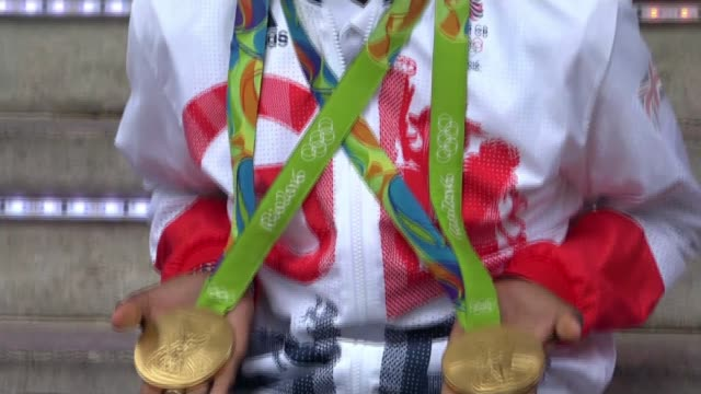 Mo Farah prepares for 5000m final LIB / 2182016 BRAZIL Rio de Janeiro Various of Farah posing with gold medals worn at the Rio 2016 Olympic Games