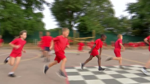 pupils at dina ashersmith former school inspired by her 200m victory england kent orpington perry hall primary school int various of schoolchildren... - playground stock videos & royalty-free footage