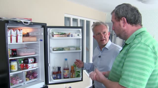 'a world away from westminster' poverty in liverpool england liverpool int dominic barber opening fridge and talking to reporter on what food came... - bedroom stock videos & royalty-free footage