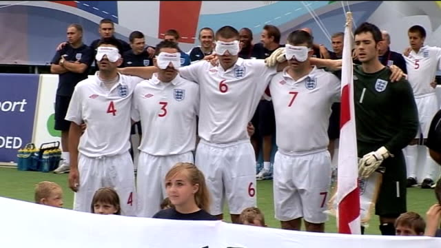 World Blind Football Championship 2010 underway in Hereford England blind footballers singing national anthem SOT Signs for football teams from...