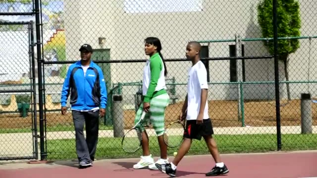 cc7786c28f4 World champion tennis player Venus and Serena Williams servers as an  instructor at a youth clinic