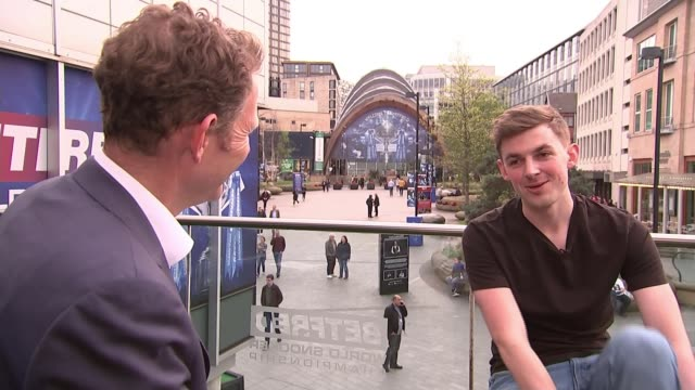 ronnie o'sullivan crashes out in stunning defeat to james cahill england sheffield ext james cahill setup shot with reporter and interview sot - world championship stock videos & royalty-free footage