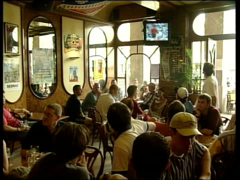 toulouse / german violence france toulouse seq england fans drinking and singing at pavement cafe two police on duty one holding walkietalkie cms... - hooligan stock videos & royalty-free footage
