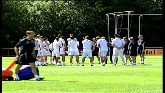 wayne rooney cleared to take part; baden-baden: england football squad bus along past general back view of england football team gathered on pitch... - sports team stock videos & royalty-free footage