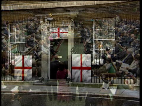 wayne rooney cleared to take part; graphicised sequence 10 downing street with cross of st george england flags flying outside/ england flag draped... - part of点の映像素材/bロール
