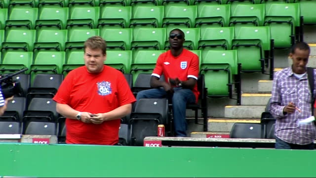 dizzee rascal and james corden record 'shout for england' world cup song three men kicking football about on pitch / james corden and dizzee rascal... - fifa world cup 2010 stock videos & royalty-free footage