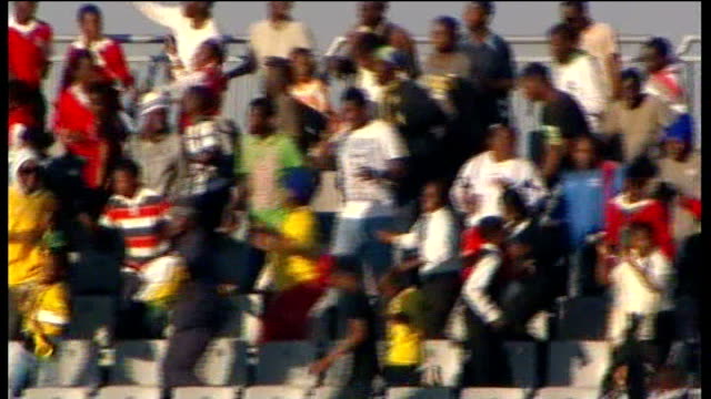 england beat platinum stars in warm-up match; people arriving at match and having tickets checked man being searched and along man waving england... - fifa world cup 2010 stock videos & royalty-free footage