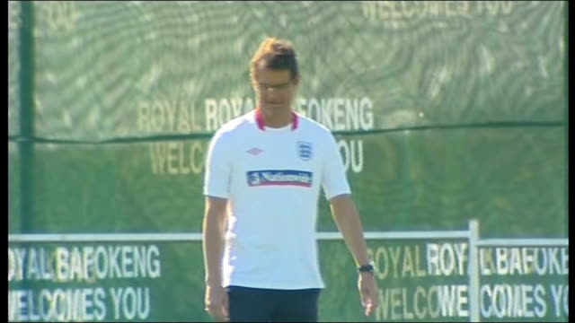 england training south africa rustenburg ext fabio capello kicking football / england players peter crouch jamie carragher and glen johnson chatting... - fußballweltmeisterschaft 2010 stock-videos und b-roll-filmmaterial