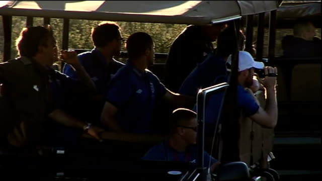 fabio capello argues with photographers t08061024 england footballers in jeep on safari bonding session wayne rooney filming animals on video camera - fifa world cup 2010 stock videos & royalty-free footage