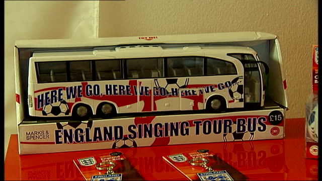 gordon banks and roger hunt interviews england world cup 2010 merchandise memorabilia on display in shop including england football shirts england... - swimming costume stock videos and b-roll footage