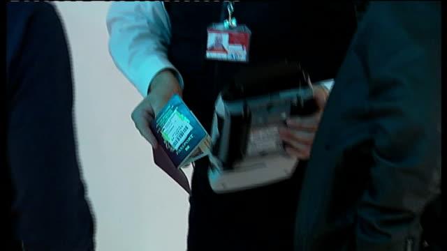 police operation to prevent hooligans travelling to south africa; england: london: heathrow airport: int police officer looking at information board... - fifa bildbanksvideor och videomaterial från bakom kulisserna