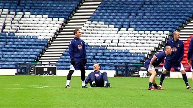 world cup 2010 qualifiers: scotland squad training; generic shots of scotland squad training close-up of mcgregor training close-up of alan hutton... - torschuss stock-videos und b-roll-filmmaterial