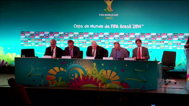 protests in brasilia / concerns over readiness of stadiums; file: 27.3.2014 rio de janeiro: int fifa delegation taking seats at press confernce... - 2014 stock-videos und b-roll-filmmaterial