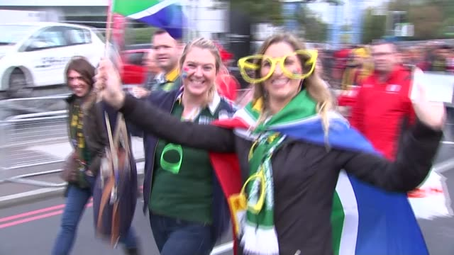 world cup 2015: quarter final matches; south african supporters along back view supporters along to stadium with south african flag - quarterfinal round stock videos & royalty-free footage