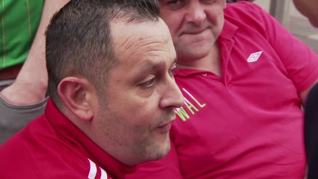 wales v republic of ireland buildup cardiff wales football fans gathered outside city centre pub/ vox pop/ cardiff city stadium reporter to camera/... - championships stock videos and b-roll footage