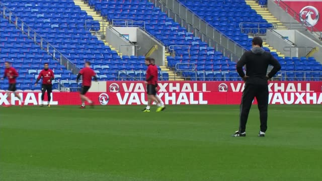 Wales v Republic of Ireland buildup WALES Cardiff Cardiff City Stadium EXT Various of Wales football team training on pitch / Chris Coleman press...