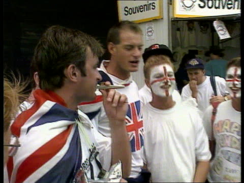 stockvideo's en b-roll-footage met england beat australia australia sydney ms english cricket fans with painted faces singing national anthem sof - channel 4 news